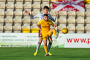 Steven Lawless (#11) of Livingston FC shields the ball from Aaron Hickey (#51) of Heart of Midlothian FC during the Ladbrokes Scottish Premiership match between Livingston FC and Heart of Midlothian at the Tony Macaroni Arena, Livingston, Scotland on 26 October 2019.
