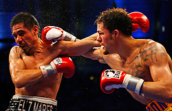 April 12, 2008; Atlantic City, NJ, USA;  Antonio Margarito (Black w/Red) takes a right hand from Kermit Cintron (Gold w/Red) during their 12 round IBF Welterweight Championship fight at Boardwalk Hall in Atlantic City, NJ. Margarito knocked out Cintron in the 6th round to capture the title.
