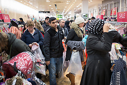© Licensed to London News Pictures . 26/12/2014 .  Manchester , UK . Crowds of bargain hunters in Next in Manchester's Arndale Centre for a 6AM opening for the Boxing Day Sale . Photo credit : Joel Goodman/LNP