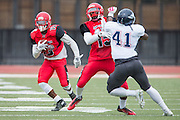 Community College of San Francisco running back Namane Modise (13) carries the ball against College of Siskiyous at Community College of San Francisco in San Francisco, Calif., on September 10, 2016. (Stan Olszewski/Special to S.F. Examiner)