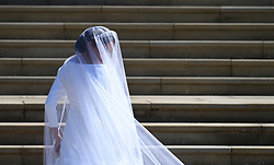 © Licensed to London News Pictures. 19/05/2018. London, UK.   Meghan Markle, The Duchess of Sussex wearing a veil, as she arrives at St George's Chapel in Windsor Castle for her wedding ceremony to PRINCE HARRY, Duke of Sussex. . Photo credit: LNP