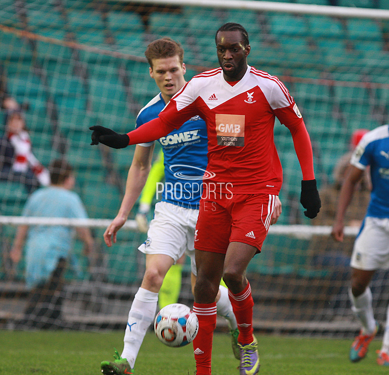 Whitehawk midfielder Arnaud Mendy shields the ball from Dover defender Sean Raggett during the FA Trophy match between Whitehawk FC and Dover Athletic at the Enclosed Ground, Whitehawk, United Kingdom on 12 December 2015. Photo by Bennett Dean.