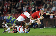 Gethin Jenkins, prop of the British Lions is tackled by Lions locks Willem Stoltz and no.4 Brad Mockford.<br /> Rugby - 090602 - British&Irish Lions v Xerox Lions - Coca-Cola Park - Johannesburg - South Africa. The British Lions won 74-10 scoring 10 tries.<br /> Photographer : Anton de Villiers / SASPA