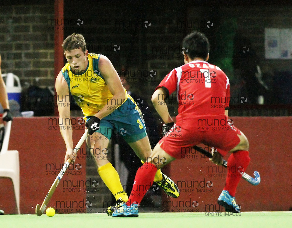 (Canberra, Australia---29 March 2012) Simon Orchard of the Australia Kookaburra national field hockey team playing in the first of a three game test series against Japan. 2012 Copyright Photograph Sean Burges / Mundo Sport Images.