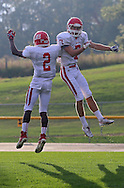 Cedar Rapids Washington's Isaiah Nimmers (2) and Clayton Bjornsen (7) celebrate after Bjornsen's 30 yard touchdown reception during their game at Xavier High School in Cedar Rapids on Friday, October 4, 2013. Washington defeated Xavier 26-10.