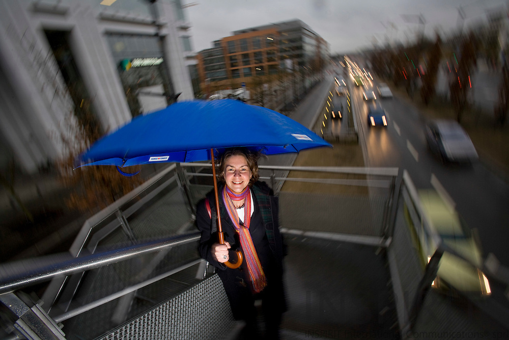 LUXEMBOURG - LUXEMBOURG - 18 JANUARY 2008 -- Tonika HIRDMAN, Country Executive ABN AMRO Bank Luxembourg, pictured  with a umbrella on a walkingbridge next to her officebuilding at Av. J.F. Kennedy. Photo: Erik Luntang/