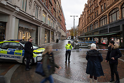 © Licensed to London News Pictures. 06/12/2019. London, UK. Police guard a cordon outside Harrods after a man was stabbed to death on Hans Crescent in the early hours of this morning.  Photo credit: George Cracknell Wright/LNP