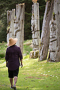 Haida guide, Elsie Stewart-Barton walks among the totems at SGang Gwaay, a UNESCO World Heritage Site in Haida Gwaii.