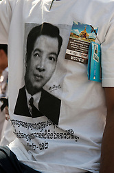 © Licensed to London News Pictures. 01/02/2013. Location, Cambodia. Mourner wears a t-shirt depicting the Late former King Norodom Sihanouk. Thousands of mourners lined the streets of Phnom Penh as part of the late kings royal funeral procession ahead of his Feb. 4, cremation Friday, Feb. 1, 2013, in Phnom Penh, Cambodia.  Photo credit : Charles Fox/LNP