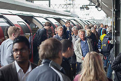 © licensed to London News Pictures. London, UK 31/07/2012. People getting off from a Central Line train at Stratford (Olympic Park). The line operated with severe delays and temporarily lost its connection to Stratford (Olympic Park) on 31/07/12. Photo credit: Tolga Akmen/LNP