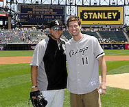 "CHICAGO - JULY 06:  Actor Ryan McPartlin, star of the television series ""Chuck"", poses with White Sox pitcher Mark Buehrle #56 after throwing a ceremonial first pitch prior to the game between the Chicago White Sox and Kansas City Royals on July 6, 2011 at U.S. Cellular Field in Chicago, Illinois.  The Royals defeated the White Sox 4-1.  (Photo by Ron Vesely/MLB Photos via Getty Images)  *** Local Caption *** Ryan McPartlin;Mark Buehrle"