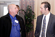 Jeff Heil of OHeil Irrigation Company (left) and Nick Keyes of Key-Ads during the South Metro Regional Chamber of Commerce Holiday Extravaganza at Sycamore Creek Country Club in Springboro, Wednesday, December 14, 2011.