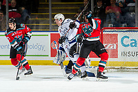 KELOWNA, CANADA - DECEMBER 7: Lane Zablocki #27 looks for the pass as Erik Gardiner #11 of the Kelowna Rockets stick checks Scott Walford #7 ahead of the net of Griffen Outhouse #30 of the Victoria Royals on December 7, 2018 at Prospera Place in Kelowna, British Columbia, Canada.  (Photo by Marissa Baecker/Shoot the Breeze)