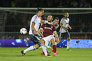 Northampton Town midfielder John-Joe O'Toole (21) tackles Zlatan Ibrahimovic Forward of Manchester United during the EFL Cup Third Round match between Northampton Town and Manchester United at Sixfields Stadium, Northampton, England on 21 September 2016. Photo by Phil Duncan.