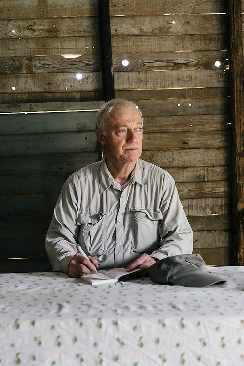 Ornithologist Tim Gallagher, takes notes inside the shelter at Farrallones in Eastern Cuba on Jan 25, 2016.