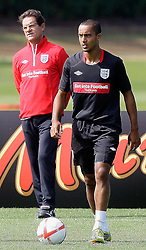09.08.2010. Arsenal Training Ground, London, ENG, Nationalteam England Training, im Bild Fabio Capello with Theo Walcott (Arsenal), EXPA Pictures © 2010, PhotoCredit: EXPA/ IPS/ Marcello Pozzetti *** ATTENTION ..*** UK AND FRANCE OUT! / SPORTIDA PHOTO AGENCY