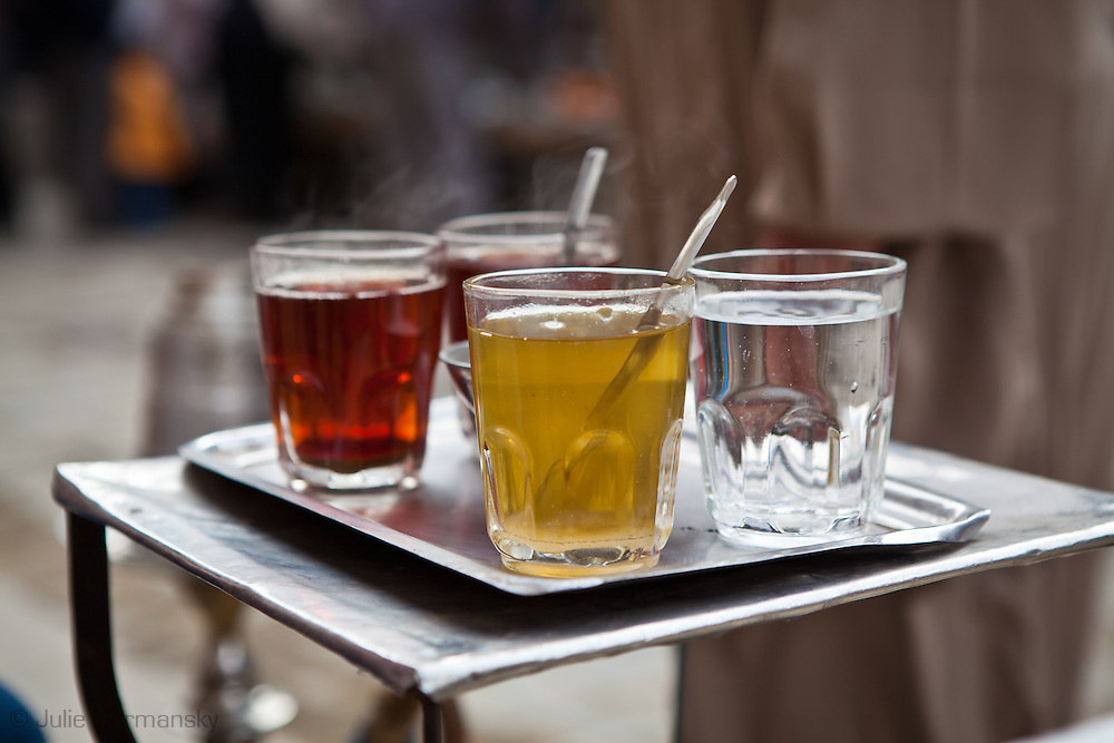 Tea served at an outdoor cafe in the Islamic Cairo where men smoke hookahs and discuss pol2itics. Cafe live returned to normal shortly after Mubarak stepped down during the revolution that began on January 25, 2011 in Egypt.