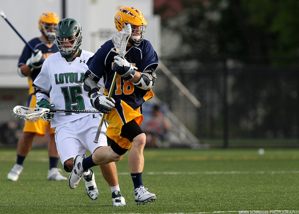 May 12, 2012; Baltimore, MD, USA; Canisius College Golden Griffins Brandon Bull (18) on a run against Loyola Maryland Greyhounds at Ridley Athletic Complex in Baltimore, MD. Mandatory Credit: Brian Schneider-www.ebrianschneider.com