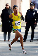 Marilson Gomes dos Santos, of Brazil, crosses the finish line of the 2006 New York City Marathon in first place on Sunday 05 November 2006<br />