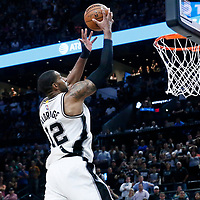 04 April 2017: San Antonio Spurs forward LaMarcus Aldridge (12) goes for the layup to tie the game at the end of regulation time during the San Antonio Spurs 95-89 OT victory over the Memphis Grizzlies, at the AT&T Center, San Antonio, Texas, USA.