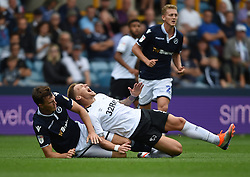 Derby County's Martyn Waghorne is fouled by Millwall's Jake Cooper. Cooper was shown a yellow card