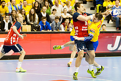 Thomas Mogensen of SG Flensburg-Handewitt and Sebastian Skube of Celje PL during handball match between RK Celje Pivovarna Lasko and SG Flensburg-Handewitt in the last sixteen of EHF Champions League 2013/14 on March 23, 2014 in Dvorana Zlatorog, Celje, Slovenia. Photo by Urban Urbanc / Sportida