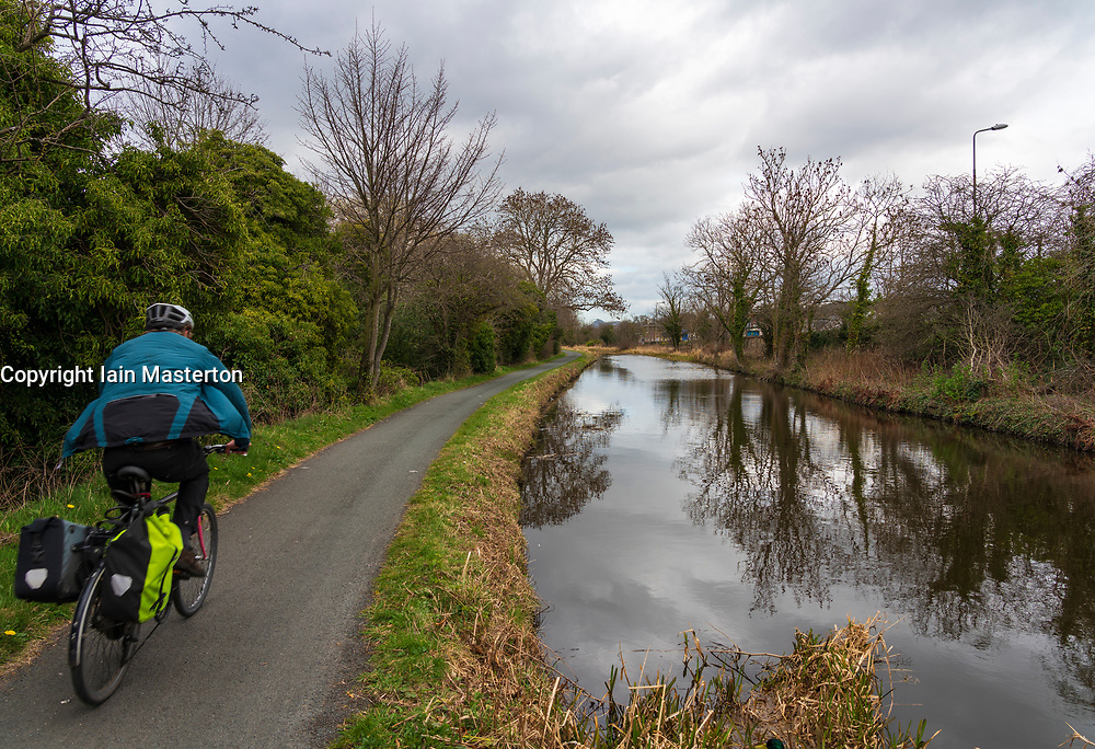Cyclist on the towpath of the Union Canal in early spring  in Edinburgh, Scotland, UK