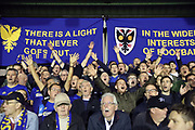 AFC Wimbledon fans singing during the EFL Sky Bet League 1 match between AFC Wimbledon and Milton Keynes Dons at the Cherry Red Records Stadium, Kingston, England on 22 September 2017. Photo by Matthew Redman.