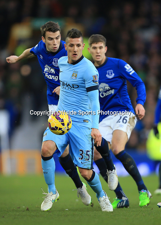 10th January 2015 - Barclays Premier League - Everton v Manchester City - Stevan Jovetic of Man City battles with Seamus Coleman of Everton - Photo: Simon Stacpoole / Offside.