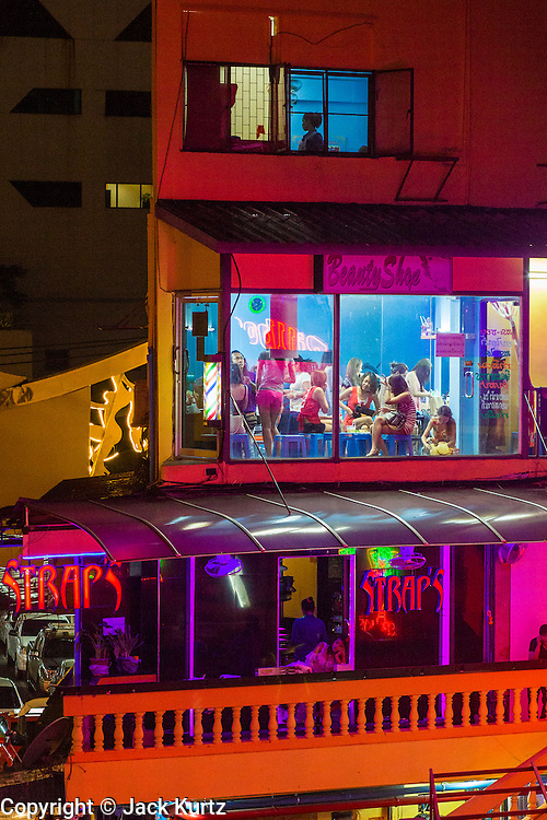 "21 JANUARY 2013 - BANGKOK, THAILAND:  Workers in the Nana Entertainment Plaza in Bangkok get their hair and makeup done before going to work in the go-go bars and brothels in the district. Prostitution in Thailand is illegal, although in practice it is tolerated and partly regulated. Prostitution is practiced openly throughout the country. The number of prostitutes is difficult to determine, estimates vary widely. Since the Vietnam War, Thailand has gained international notoriety among travelers from many countries as a sex tourism destination. One estimate published in 2003 placed the trade at US$ 4.3 billion per year or about three percent of the Thai economy. It has been suggested that at least 10% of tourist dollars may be spent on the sex trade. According to a 2001 report by the World Health Organisation: ""There are between 150,000 and 200,000 sex workers (in Thailand).""    PHOTO BY JACK KURTZ"
