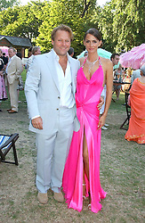 MR DAVID ROSS co-founder of CarPhone Warehouse and his girlfriend MISS SHELLEY ROSS at the Concervative Party Summer Party held in the gardnes of The Royal Hospital, Chelsea, London on 3rd July 2006.<br /><br />NON EXCLUSIVE - WORLD RIGHTS