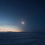 Diamond ring at the start of totality, visible across a glacier landscape on the east coast of Svalbard, Norway, 20 March 2015 (3 image composite)