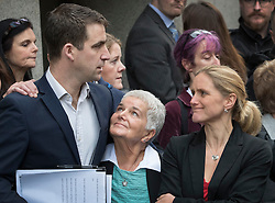 © Licensed to London News Pictures. 23/11/2016. London, UK. Family of murdered MP Jo Cox speak to reporters after Thomas Mair was found guilty of her murder. Jo Cox's mother Jean Leadbeater and sister Kim Leadbeater look up to her husband Brendan Cox after he spoke to reporters outside The Old Bailey .Defendant Thomas Mair chose not to give any evidence in his defence.  Mair shot and stabbed the 41-year-old Member of Parliament outside her constituency surgery in Birstall, near Leeds, Yorkshire on June 16 this year and has been given a whole life sentence. Photo credit: Peter Macdiarmid/LNP