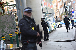 © Licensed to London News Pictures. 29/11/2019. London, UK.  Emergency response agencies react to a major incident on London Bridge, evacuating nearby Borough Market and office blocks as shots are fired near a bus..  Photo credit: Guilhem Baker/LNP