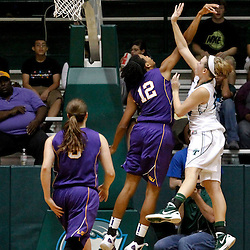 November 19, 2011; New Orleans, LA; Tulane Green Wave forward Danielle Blagg (20) shoots the game winning shot over LSU Lady Tigers forward Krystal Forthan (12) during the overtime of a game at Avron B. Fogelman Arena. Tulane defeated LSU 65-62 in overtime. Mandatory Credit: Derick E. Hingle-US PRESSWIRE