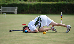 © Licensed to London News Pictures. 14/08/2013. Surbiton, UK. Andrew Johnston, Ireland in action. People participate in the14th World Association Croquet Championship at the Surbiton Croquet Club, Kingston upon Thames on the 14th August 2013. The Final will be played on Sunday 18th August. 80 competitors from 20 countries are taking part. Photo credit : Mike King/LNP