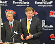 Mississippi athletic director Pete Boone (right) speaks at a press conference as Chancellor Dan Jones listens at the IPF at the University of Mississippi in Oxford, Miss. on Monday, November 7, 2011. Boone announced that head football coach Houston Nutt will not be retained following the season. Boone also announced that he will resign as athletic director by December 31, 2012.