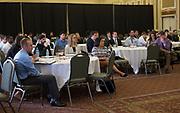 Attendees of the Darren Butler Sports Business Forum listen to panelists on September 22, 2017.
