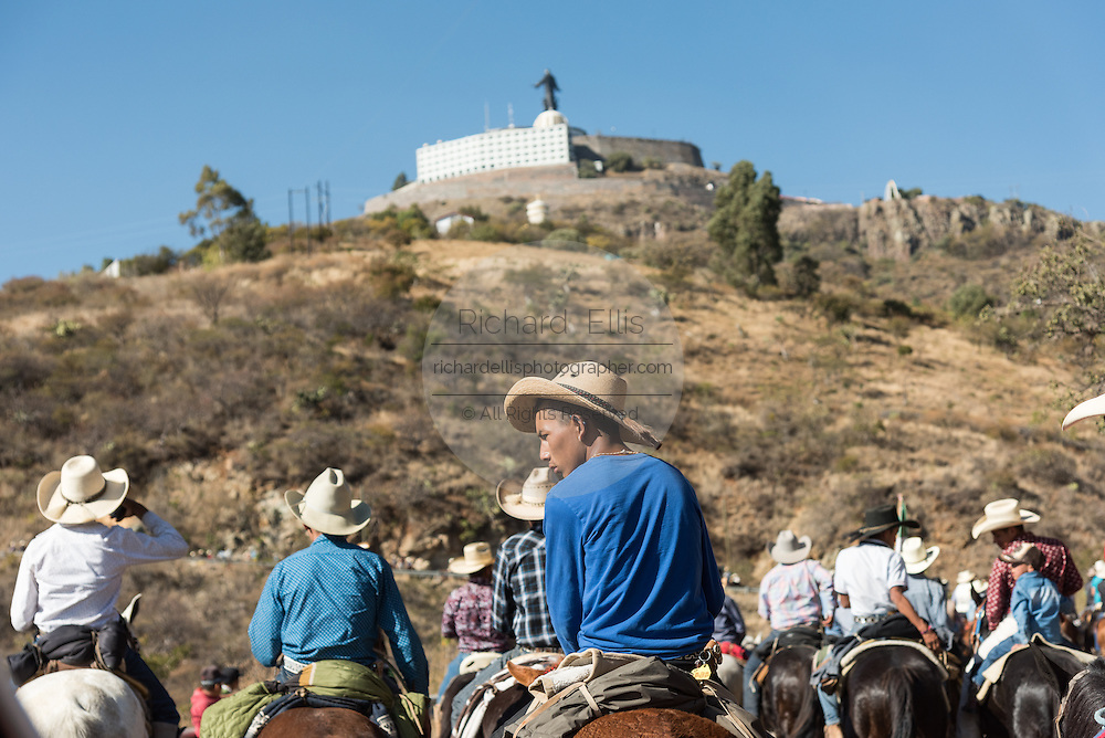 Hundreds of Mexican cowboys ride the final leg up Cubilete Mountain to the Cristo Rey shrine during the annual Cabalgata de Cristo Rey pilgrimage January 5, 2017 in Silao, Guanajuato, Mexico. Thousands of Mexican cowboys and horse take part in the three-day ride to the mountaintop shrine of Cristo Rey.
