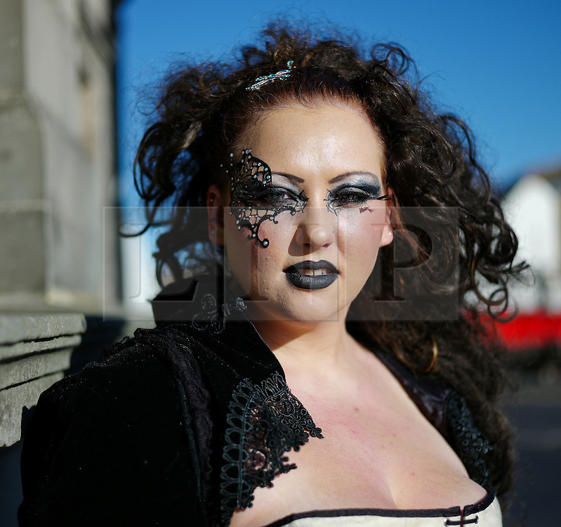 © Licensed to London News Pictures. <br /> 01/11/2014. <br /> <br /> Whitby, Yorkshire, United Kingdom<br /> <br /> Zoe Crawford, 24, from Lincoln visits Whitby Goth Weekend on the 20th anniversary of the event in the town.. <br /> <br /> The event this weekend brings together thousands of extravagantly dressed followers of Victoriana, Steampunk, Cybergoth and Romanticism who all visit the town to take part in celebrating Gothic culture. This weekend marks the 20th anniversary since the event was started by local woman Jo Hampshire.<br /> <br /> Photo credit : Ian Forsyth/LNP