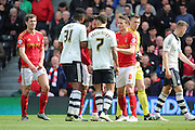 Fulham defender Ryan Fredericks (07) and Nottingham Forest defender Daniel (Danny) Fox (13) touching heads during the Sky Bet Championship match between Fulham and Nottingham Forest at Craven Cottage, London, England on 23 April 2016. Photo by Matthew Redman.