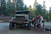 gMack uses an old truck as a kickstand along the Great Western Divide Highway - Sequoia National Monument - CA - Adventure Cycling Sierra Cascades Route - Canada to Mexico Cycling Expedition