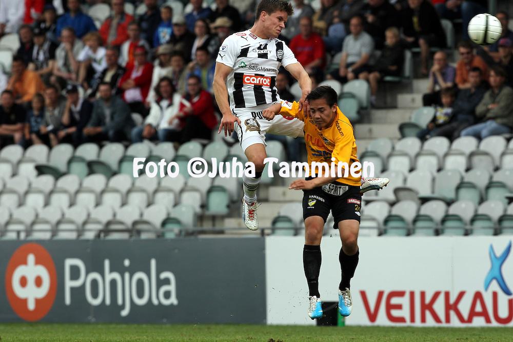 9.7.2012, Veritas stadion (Kupittaa), Turku..Veikkausliiga 2012..FC TPS Turku - FC Honka..Aleksi Ristola (TPS) v Patrick Aaltonen (Honka)..