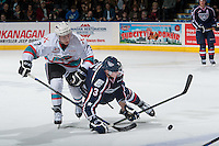 KELOWNA, CANADA - JANUARY 22: Riley Stadel #3 of Kelowna Rockets checks Mackenze Stewart #3 of Tri City Americans to the ice on January 22, 2016 at Prospera Place in Kelowna, British Columbia, Canada.  (Photo by Marissa Baecker/Shoot the Breeze)  *** Local Caption *** Riley Stadel; Mackenze Stewart;