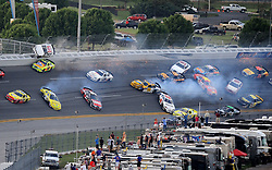 Apr 25, 2010; Talladega, AL, USA; NASCAR Nationwide Series driver Dennis Setzer (92) gies airborne into the catch fence as he crashes with Paul Menard (98), Brian Vickers (32), Justin Allgaier (12), Scott Wimmer (27), Eric McClure (24) and several others in turn four on the last lap during the Aarons 312 at the Talladega Superspeedway. Mandatory Credit: Mark J. Rebilas-US PRESSWIRE *** UK ONLY ***