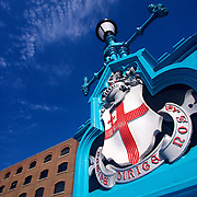 A lampost on Tower Bridge bearing the City of London's coat of arms.