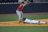 Ole Miss' Tanner Mathis (12) tags up and is safe at third as Austin Peay's Greg Bachman (5) awaits the throw at Oxford-University Stadium in Oxford, Miss. on Tuesday, March 1, 2010.