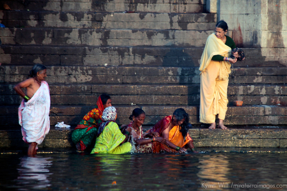 Asia, India, Varanasi. Women in colorful saris bathe in the river Ganges in Varanasi.