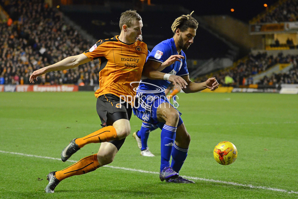 Wolverhampton Wanderers striker Jon Dadi Bodvarsson (22) battles with Birmingham City defender Ryan Shotton (5) 0-0 during the EFL Sky Bet Championship match between Wolverhampton Wanderers and Birmingham City at Molineux, Wolverhampton, England on 24 February 2017. Photo by Alan Franklin.