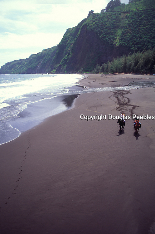 Horseback riding, Waipio Valley, Island of Hawaii, Hawaii, (editorial use only, no model release)<br />
